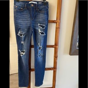 KYLIE JENNER HIGH RISE CURVY SKINNY JEANS